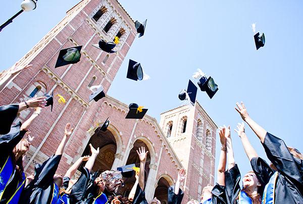 UC graduation cap tossing