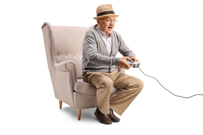 Senior man in a hat playing video games excitedly