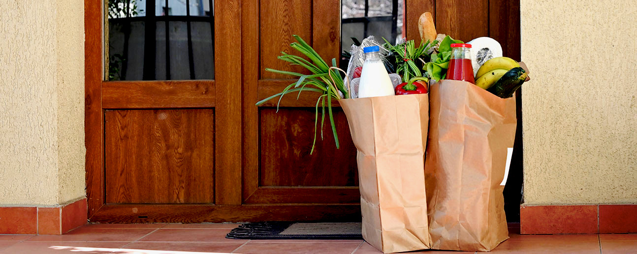 groceries sitting outside a house