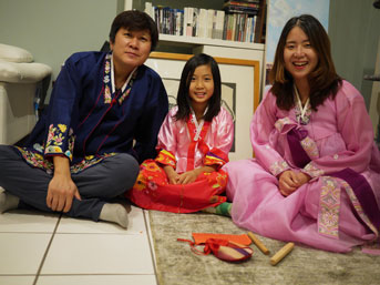Family wearing hanbok for Lunar New Year