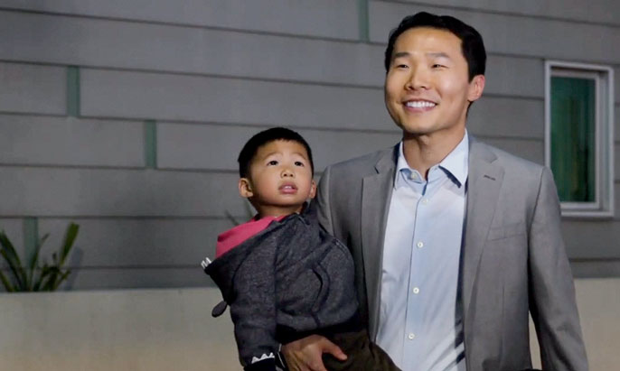 UC Riverside happy dad holds son