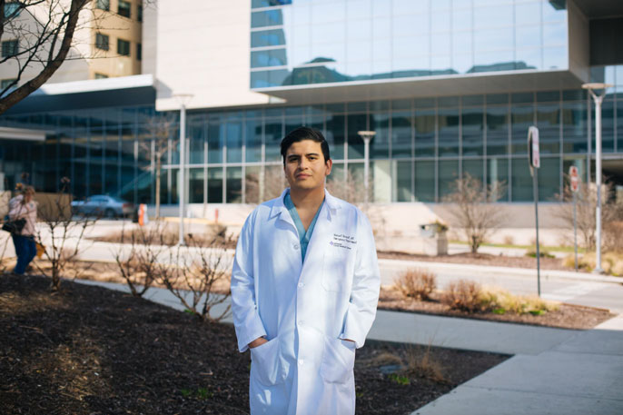 DACA medical student in front of hospital