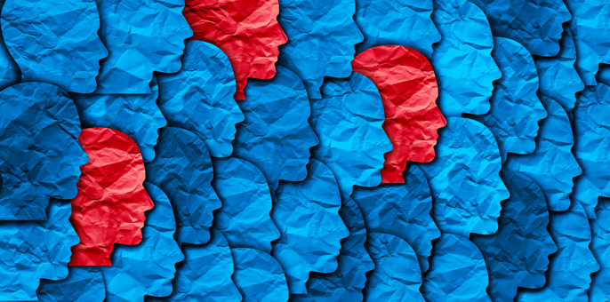 Paper faces, signifying a group, mostly blue but a few red