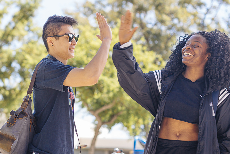 Two UC Davis students do a high-five