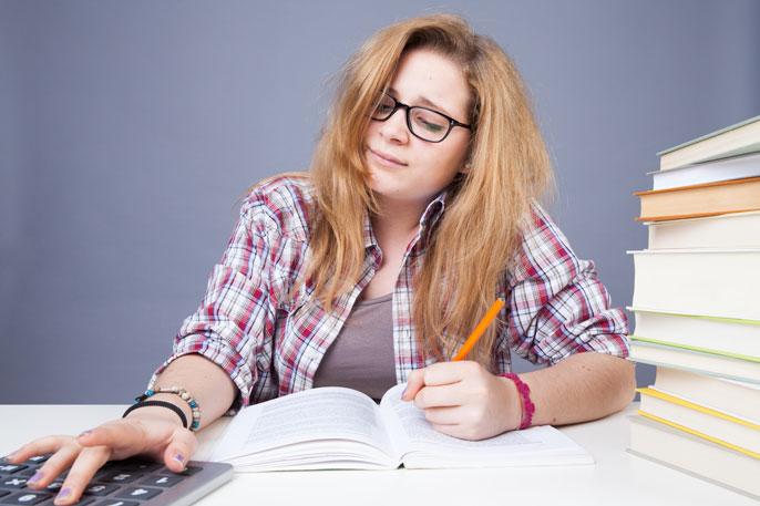 Tired student doing homework