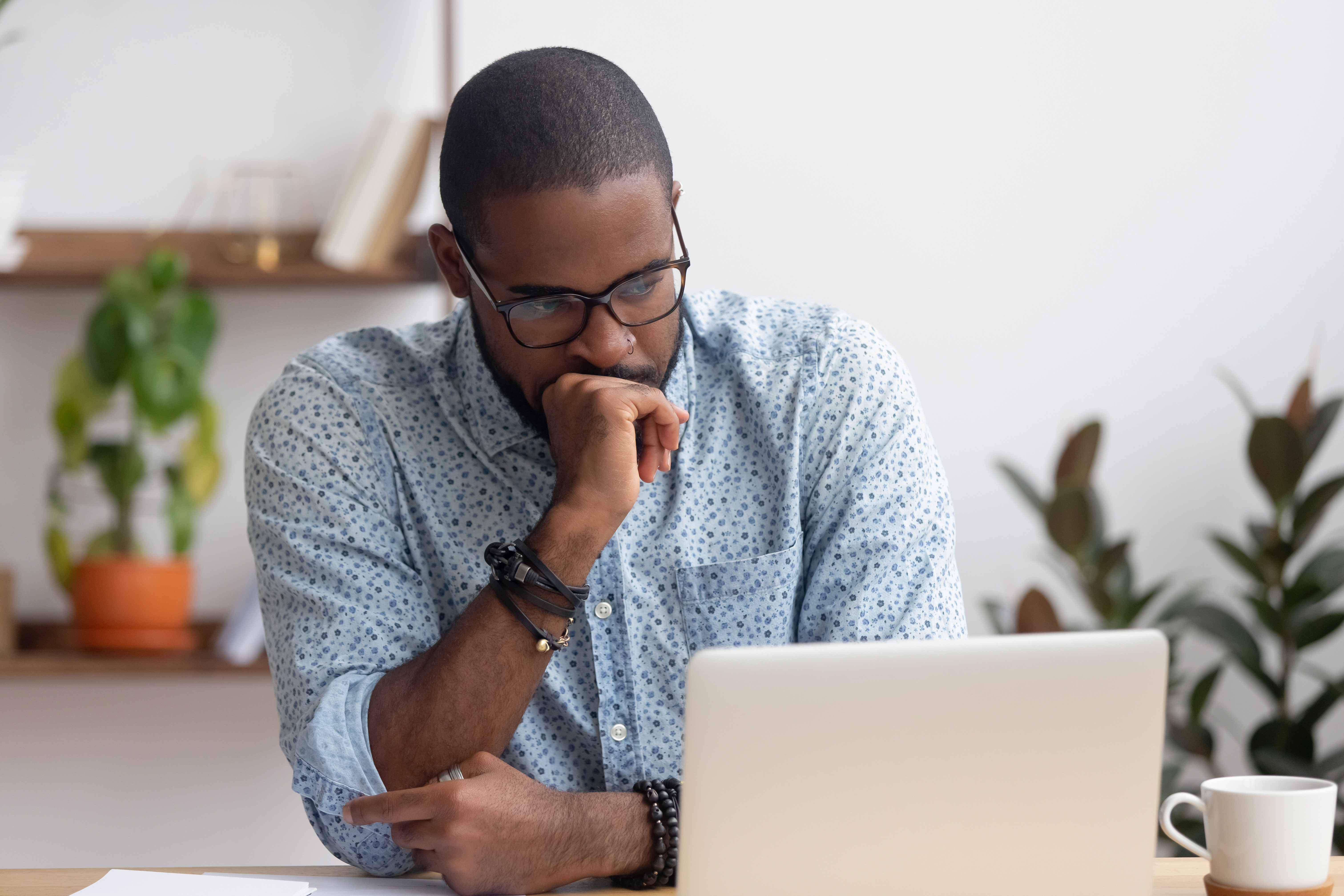Man anxiously looks at his laptop