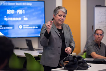 Janet Napolitano speaks to a political science class