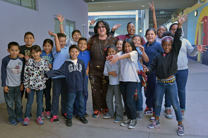 Baca and students at the Judith F. Baca Arts Academy in Watts.