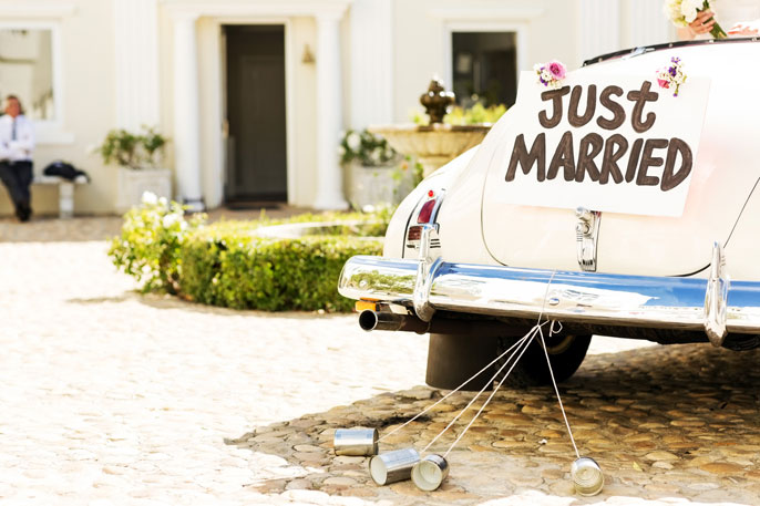 Just married old car in a sunny square