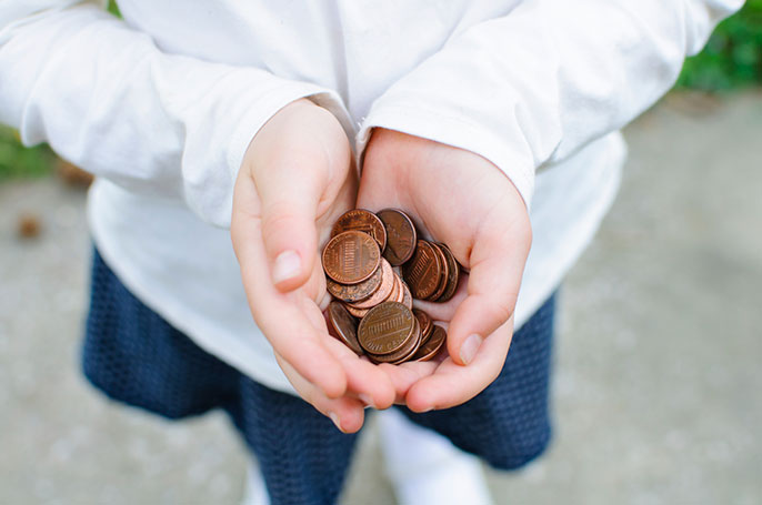 girl with pennies