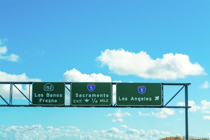 Sacramento and Los Angeles signs in 5 freeway stock photo