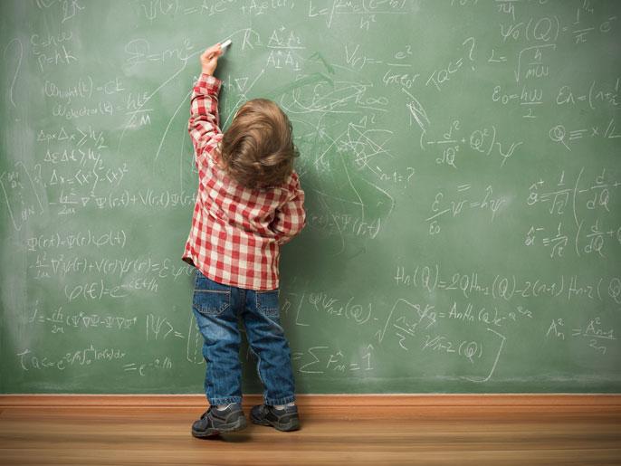 Left-handed child at blackboard