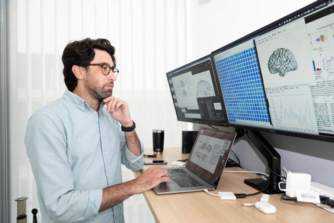 Matt Leonard looking at computer screens