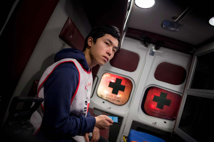Student sits in an ambulance
