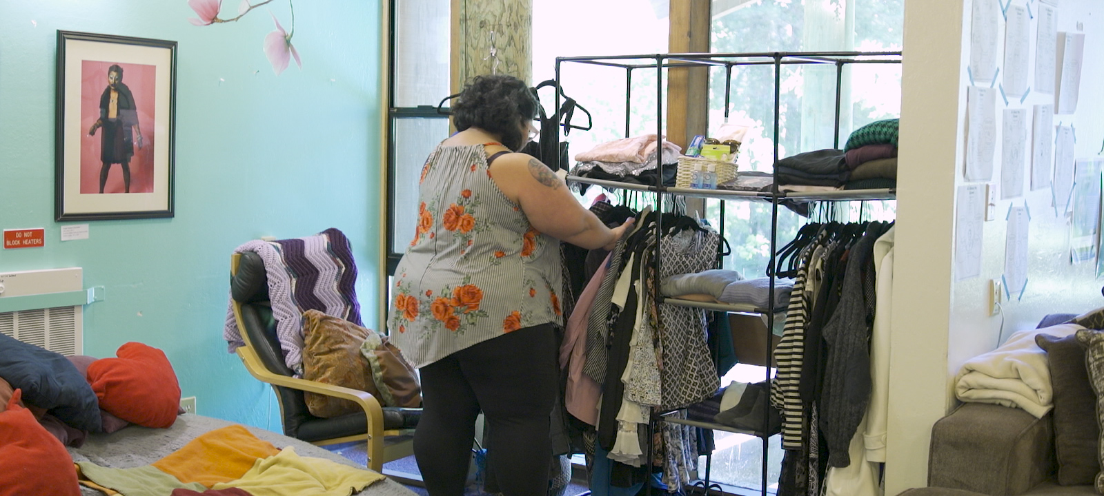 Trying on clothes at the Cantu Clothing Closet