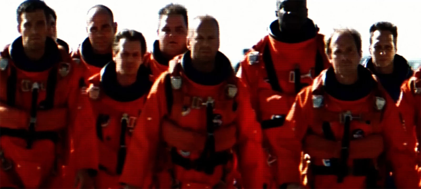 Bruce Willis and cast of Armageddon walking in spacesuits