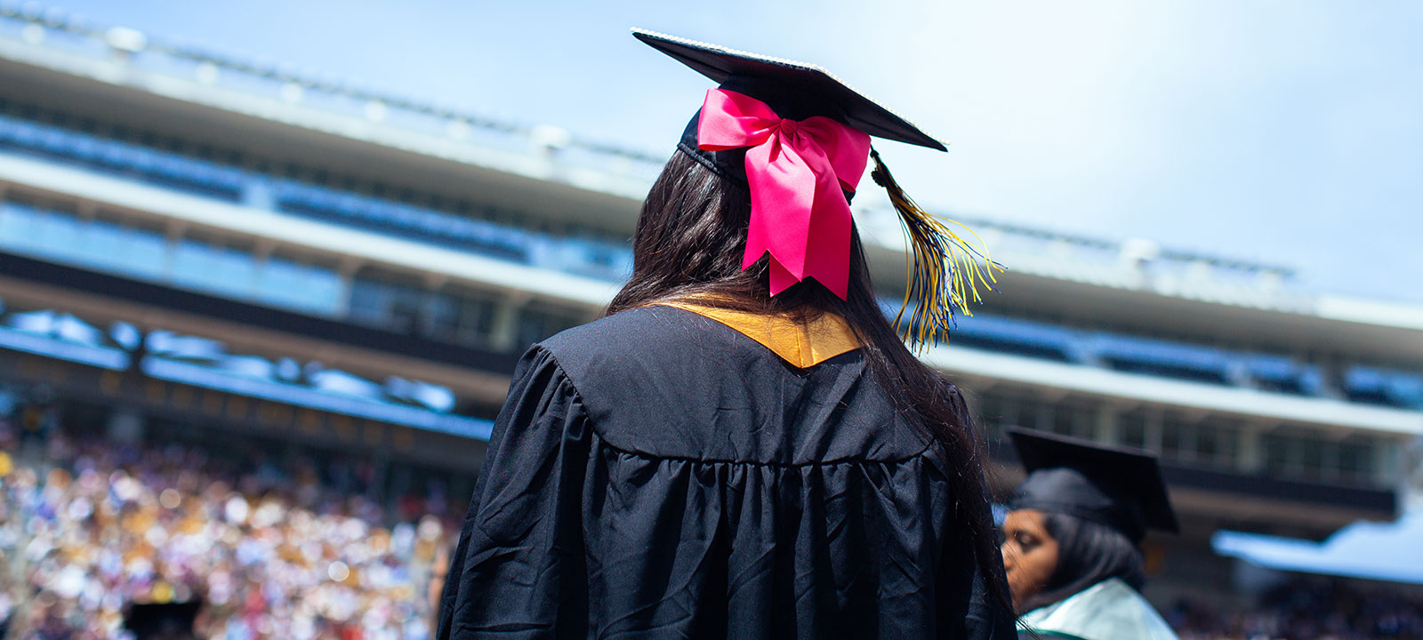 View of student in commencement cap and gown
