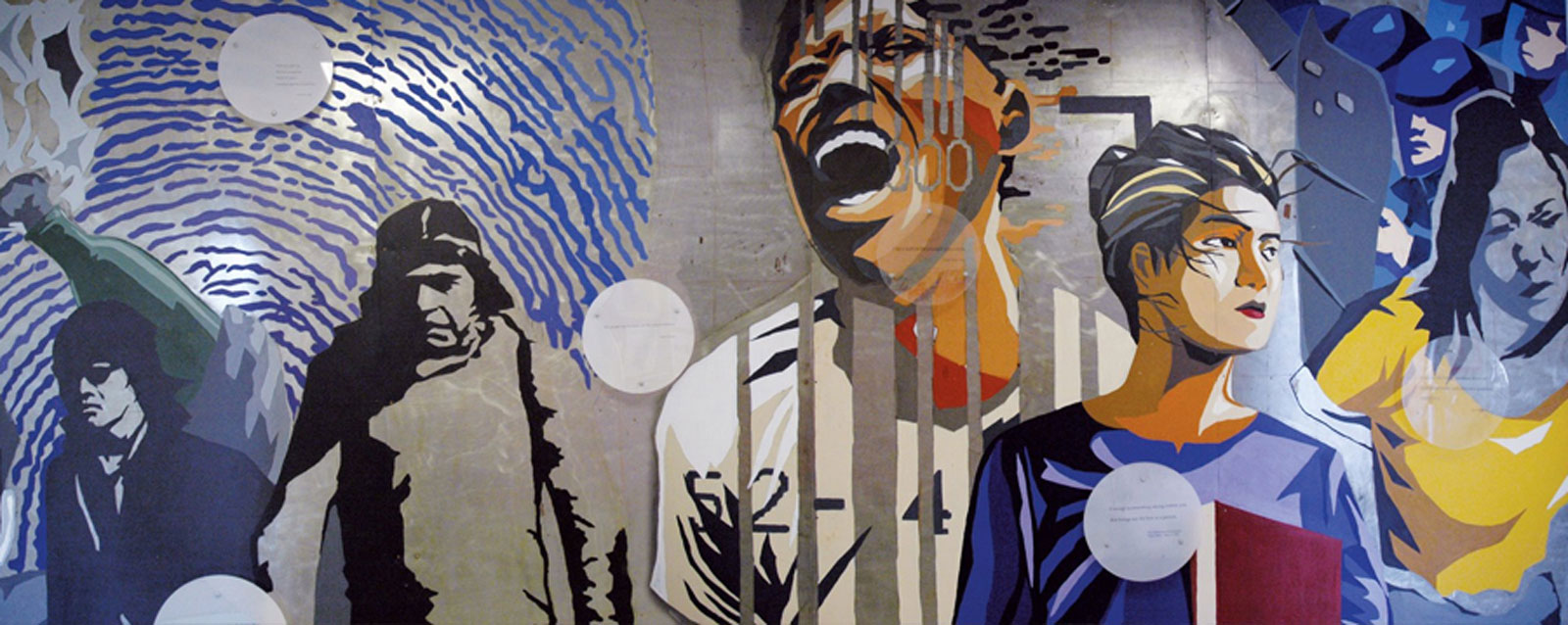"""The mural """"Education Through Struggle,"""" which is outside the Asian American Studies Center. Alumnus Darryl Mar and UCLA students painted it in 1995."""