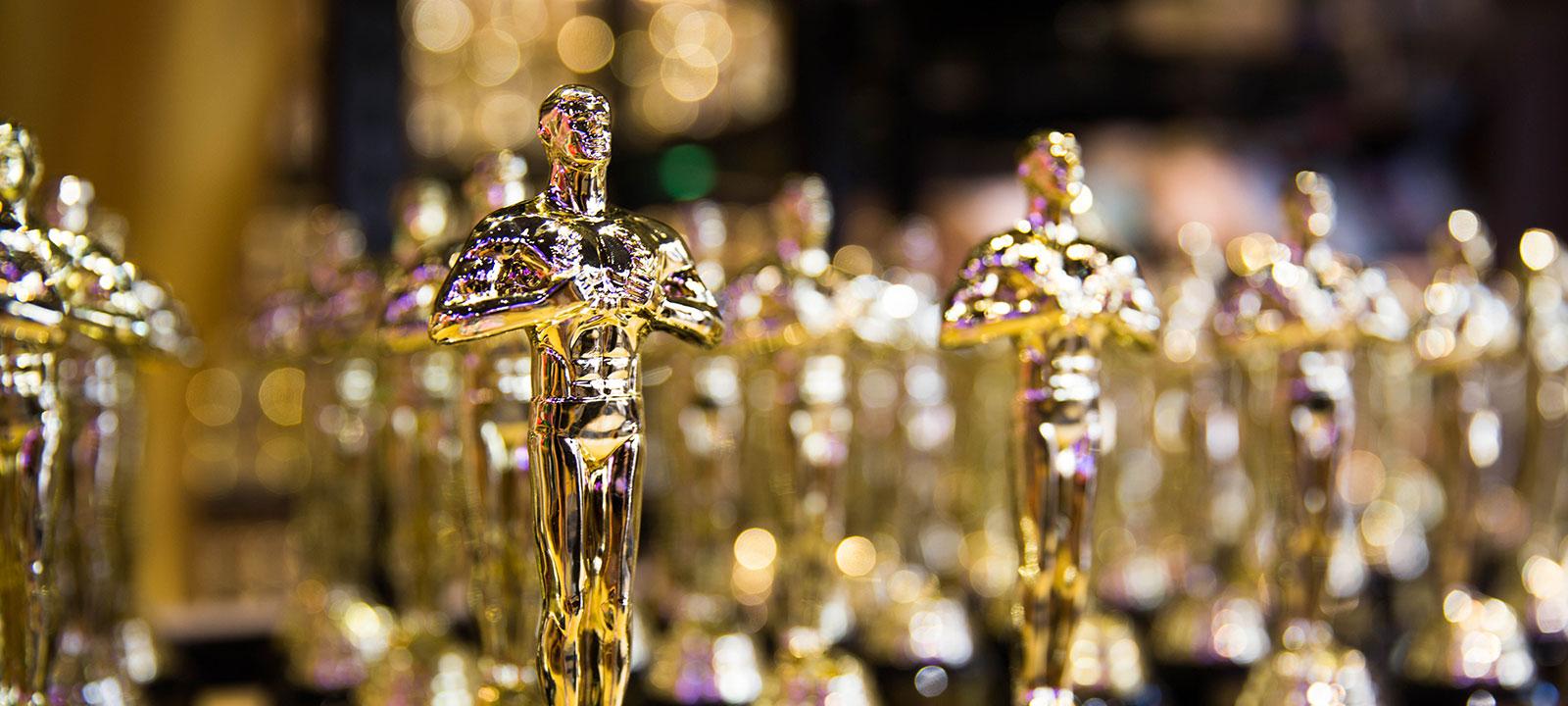 Oscar statuettes in a row
