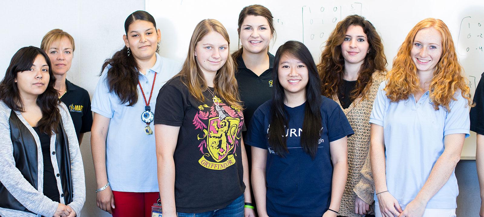 Female STEM students standing together