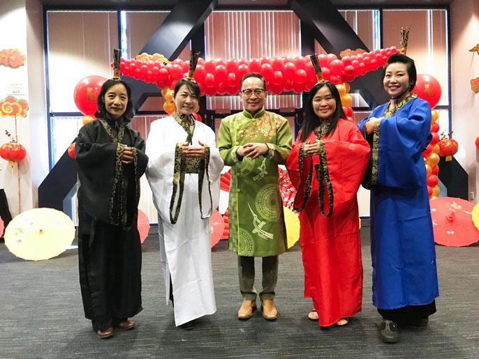 UC Irvine faculty wear traditional clothing at a Lunar New Year celebration