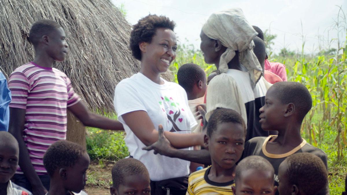 Lydia Natoolo embraces a woman near Atutur Hospital