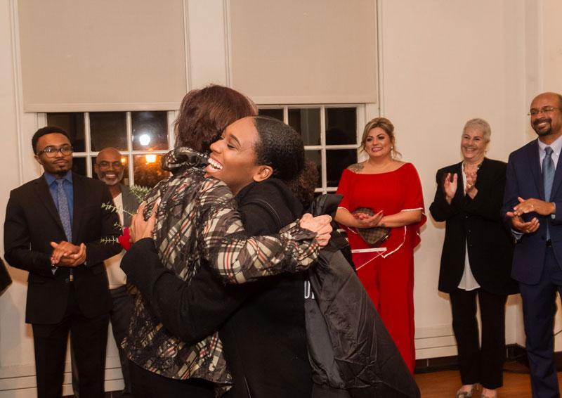 Mariah Watson hugs Sen. Nancy Skinner