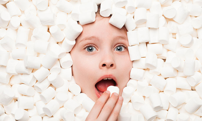Boy in a pile of marshmallows
