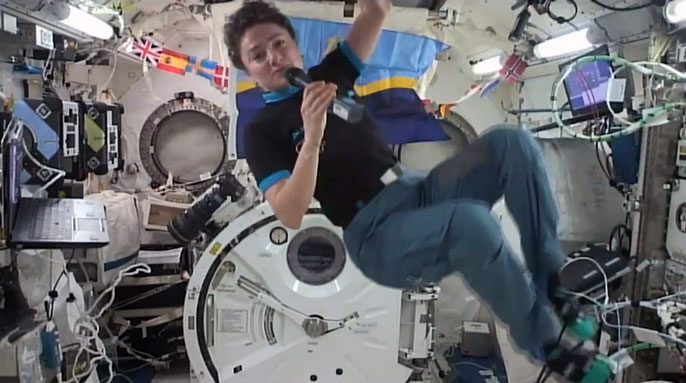 Jessica Meir floating in space taking questions