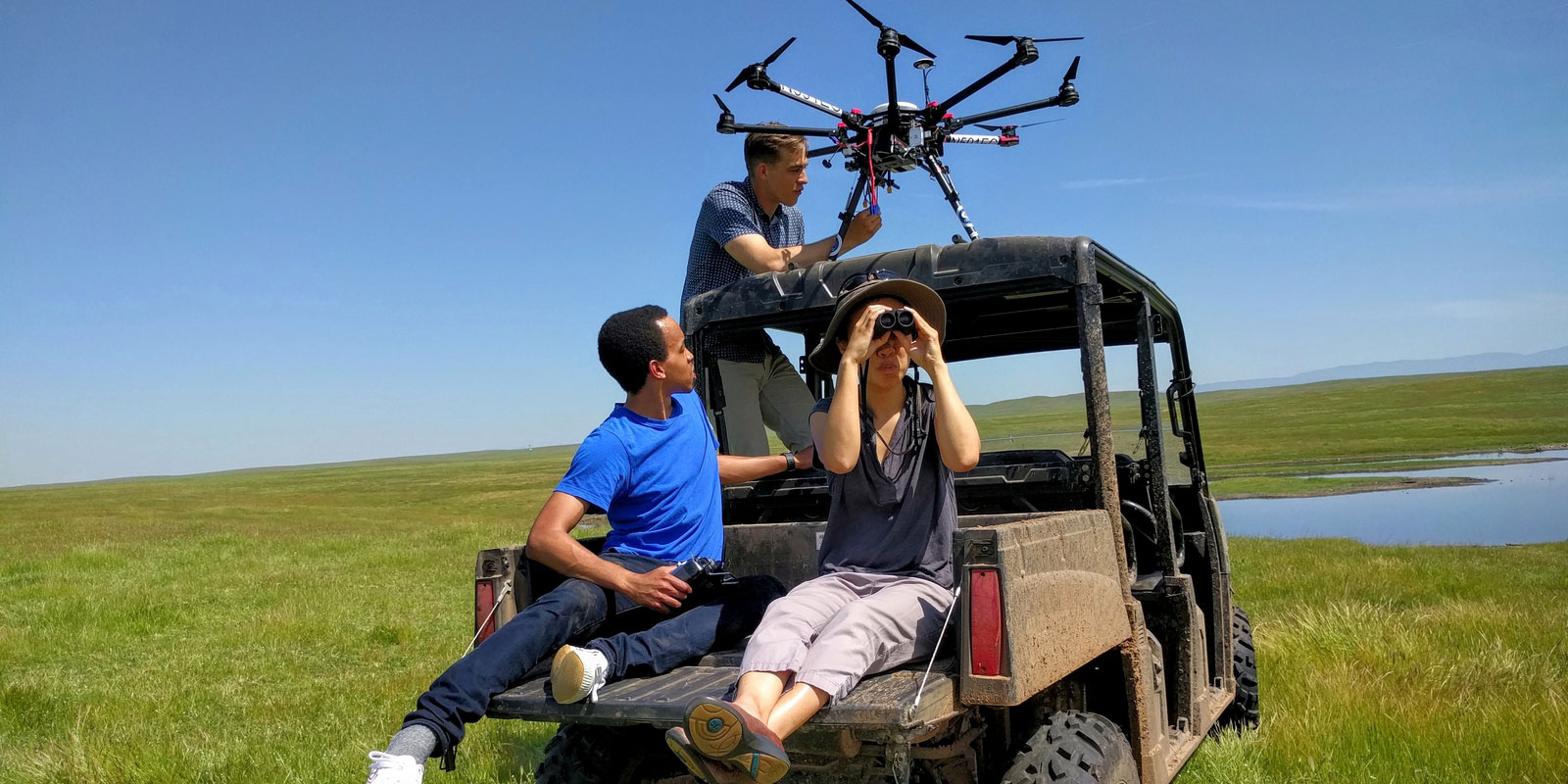 UC Merced engineering students in a field on a jeep