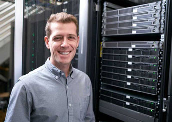 Michael Keiser in front of stack of servers