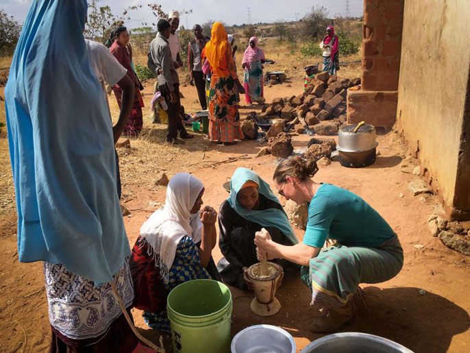 Carrie Waterman harvests moringa with locals