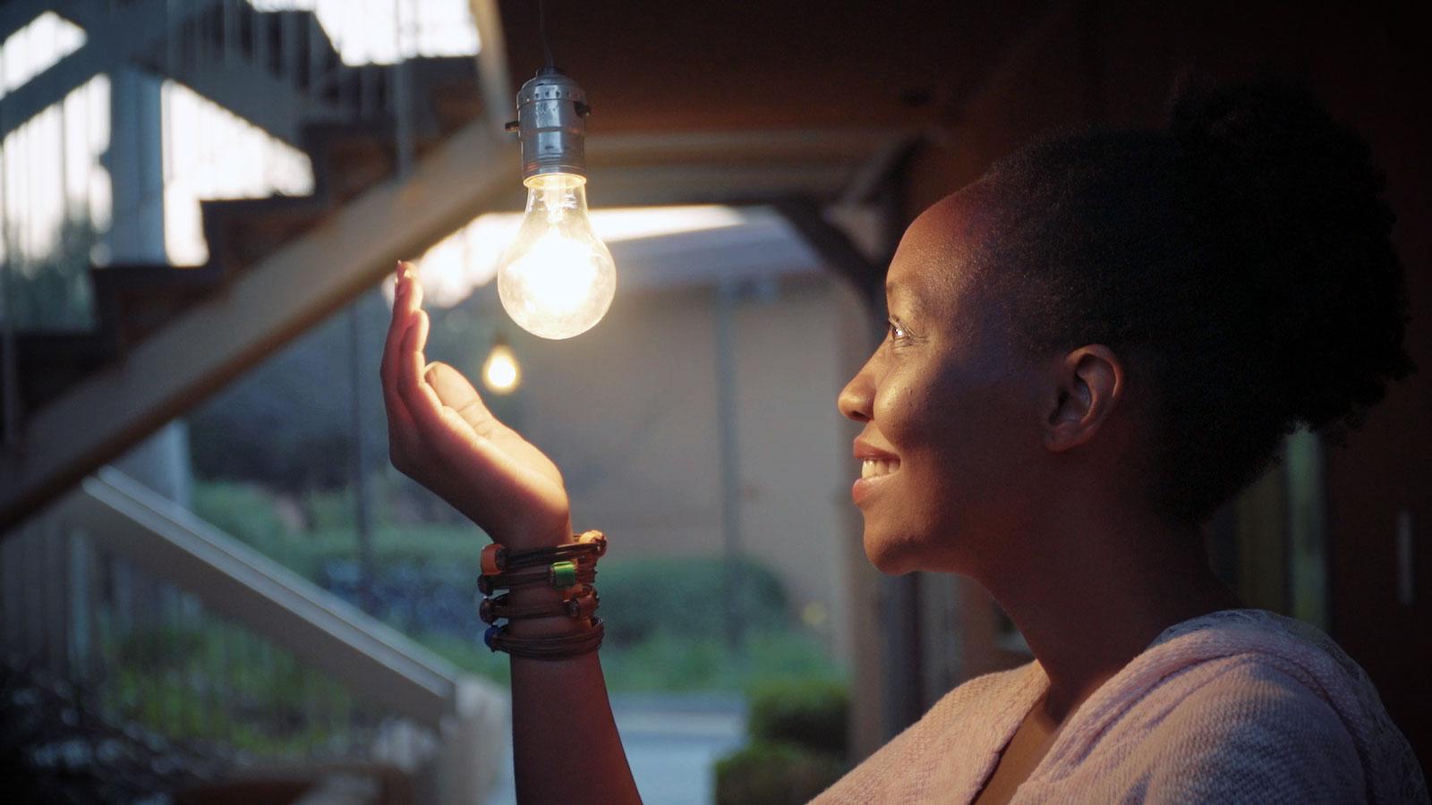 Lydia Natoolo with lightbulb