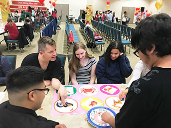 UC Irvine facultly and students play Vietnamese craps at a Lunar New Year celebration in 2020