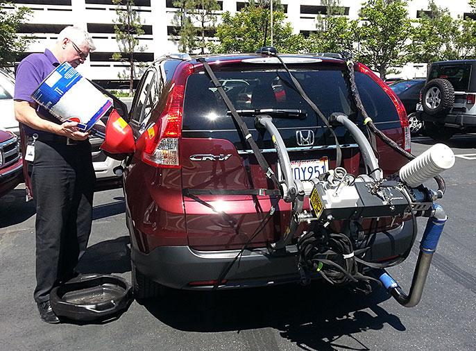 fueling up Honda CR-V