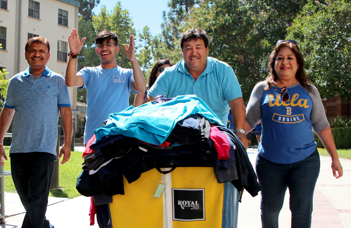 Pandey's family helps him roll a cart to his UCLA dorm