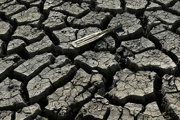 oar sits atop parched earth