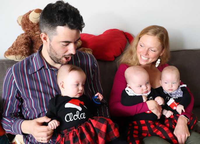 Gregor Martynus and Jana Gallus hold their triplets
