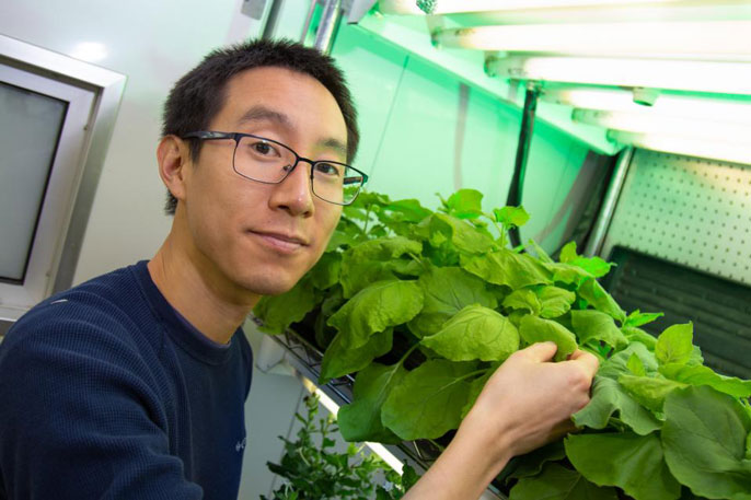Patrick Shih in front of his plants