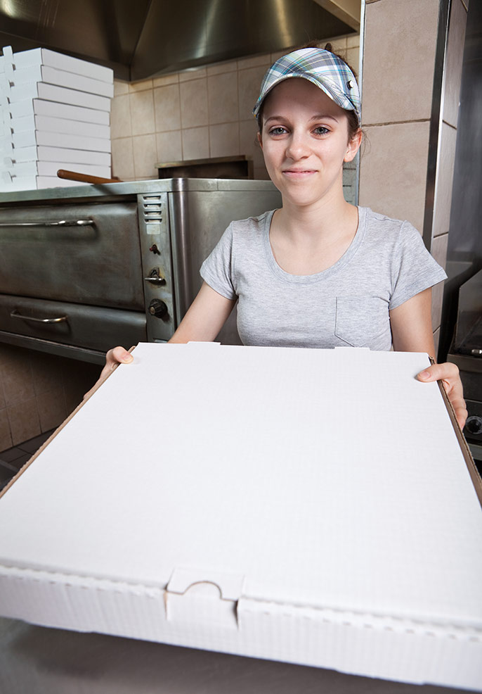 young woman working at pizza parlor