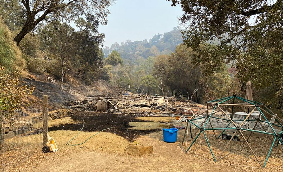 Quail Ridge Reserve director Shane Waddell's house burned to the ground, leaving little more than the foundation and his children's outdoor play structure.