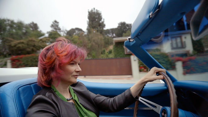 Rachelle Crosbie-Watson driving her Corvette