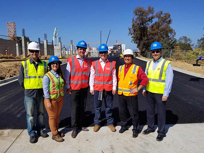 Group photo of Steve Weihe and Chelsea Klaseus, representing the City of the San Diego's Environmental Services Department, MacRebur co-founder Gordon MacRebur, MacRebur CEO Toby McCartney, and Gary Oshima and Ted Johnson of UC San Diego