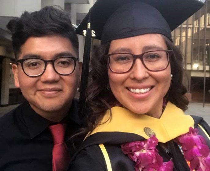 Rene Amel Peralta and sister at graduation