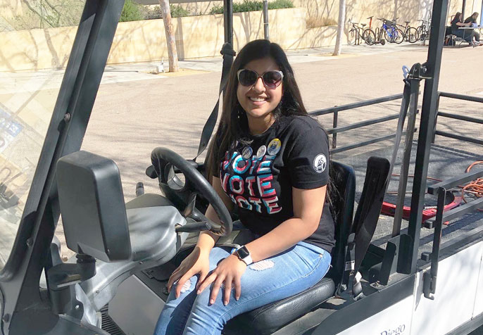 Alisha Saxena in golf cart