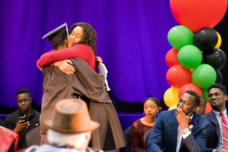 Sharee Hughes hugs a graduate