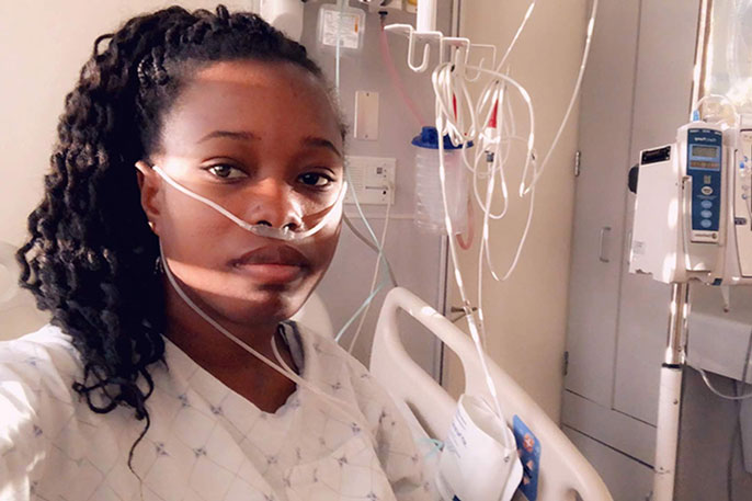 Young Black woman in hospital room