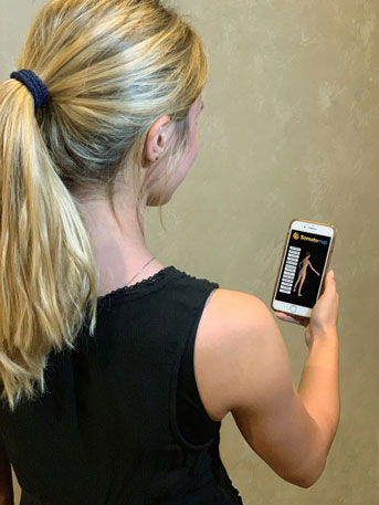 Woman holding the Somatomap app