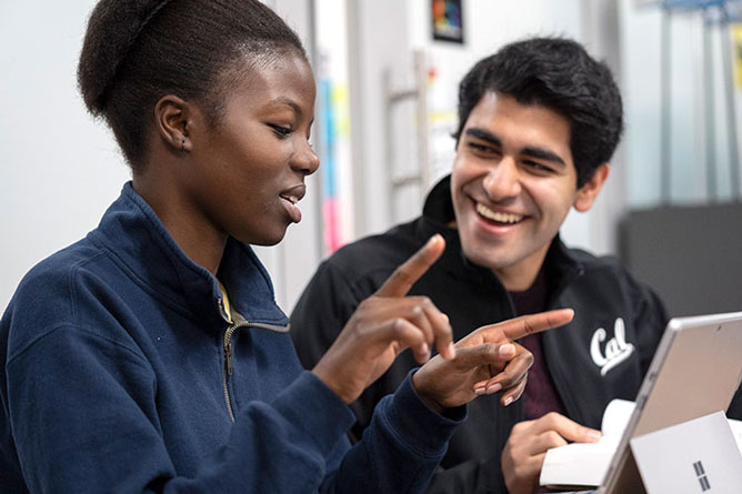 Two students talking together