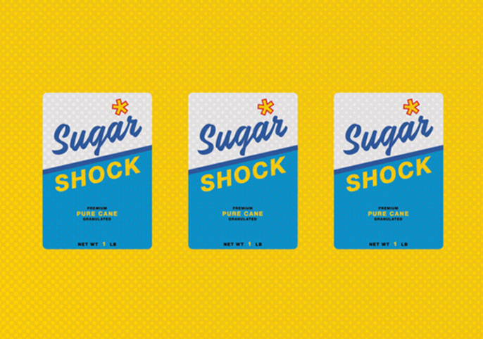 Sugar boxes that say shock in a row